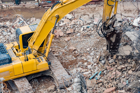 An excavator working at demolition site