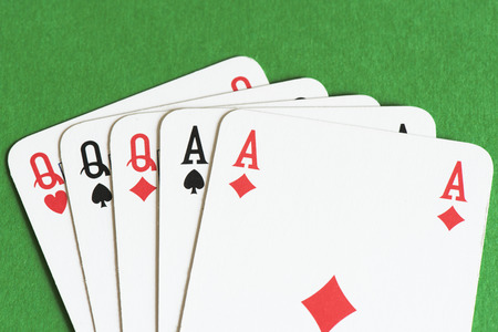 full house: Playing card on green table, Full house Stock Photo