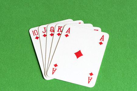 straight flush: Playing card on green table, Straight flush