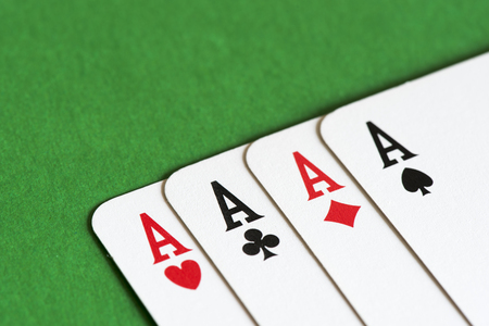 four of a kind: Playing card on green table, four a kind aces