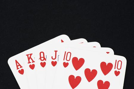 straight flush: Playing card on black table, Straight flush Stock Photo
