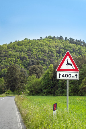 trip hazard sign: Road Sign Animal Crossing in the meadow