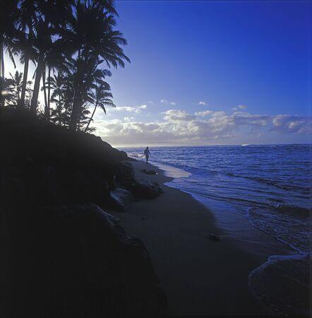 Beach stroll at sunrise Stock Photo