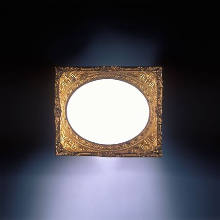 Antique gold frame with white oval