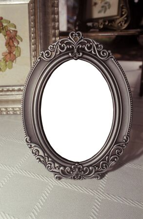 Antique frame with white oval for future image placement