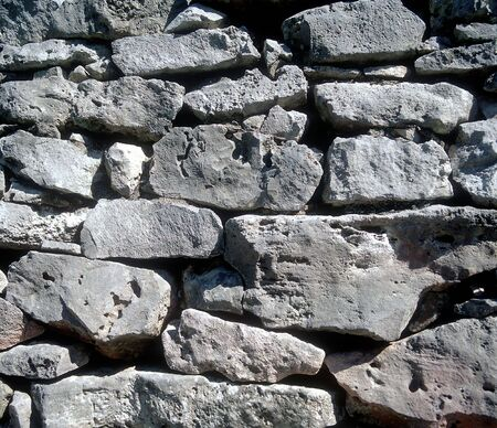 Stacked rough rock wall