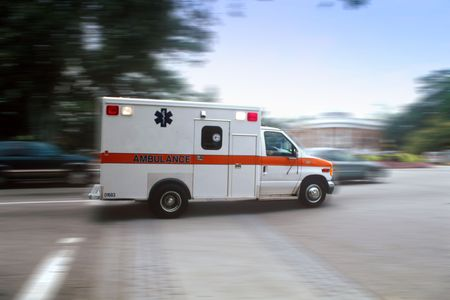 Ambulance rushing through intersection headng for the ER Stock Photo