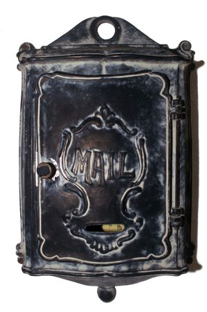 Victorian era metal mailbox isolated from background Stock Photo