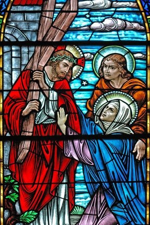 Stained glass window, in 19th century ( St Marys built 1875-1899) church, of Jesus carrying the cross on the way to Calvary. Stock Photo
