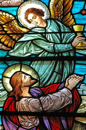 Stained glass window, in 19th century ( St Marys built 1875-1899) church, of Jesus and a heavenly angel.