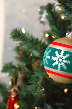 Gold Christmas tree ball ornament with lites