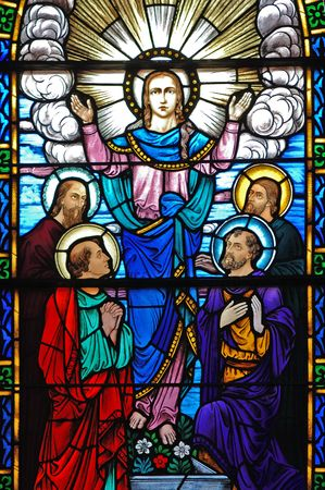 Stained glass window, in 19th century (St. Mary's built 1875 - 1899) church,  of  Christ, and disciples Matthew, Mark, Luke and John