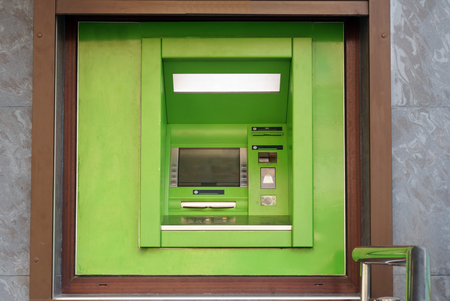 bankomat: Outdoor ATM cash machine. Withdraw money from ATM machine. Bankomat on a wall.