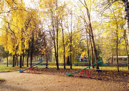 kindy: Empty playground with swings in the autumn park