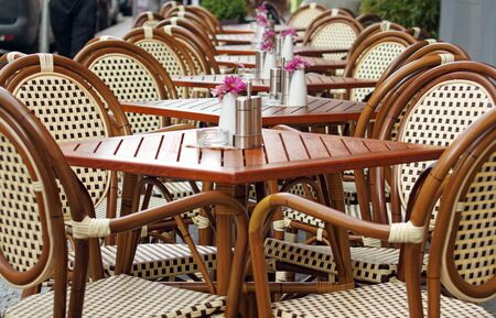Tables and chairs on empty terrace of a street cafe. Waiting for service. Stok Fotoğraf