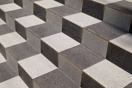Black and white tile on steps. Diagonal perspective.