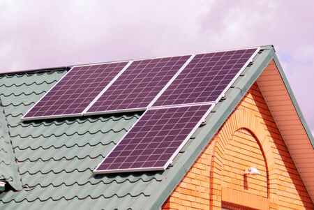 Solar panels on the roof of house. Environmental free electric power.