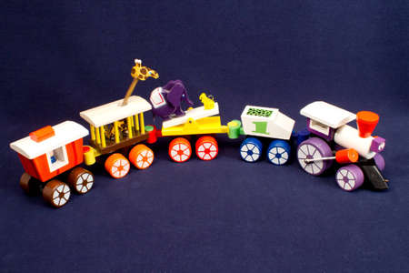 Wooden circus train pull toy with animals photo