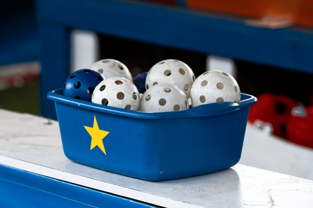 Wiffle balls in a container Stock Photo