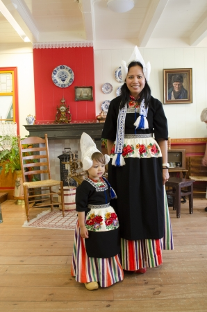 dutch girl: Mother and child in traditional dutch clothes