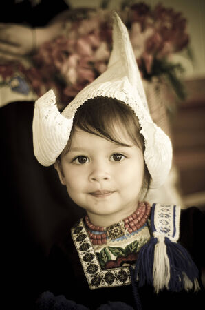dutch girl: Young girl in traditional dutch clothes