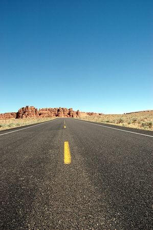 Highway running through Utahs vast desert. Stock Photo