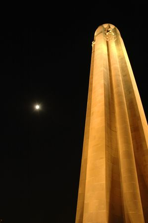 National landmark stands its own next to a full moon.