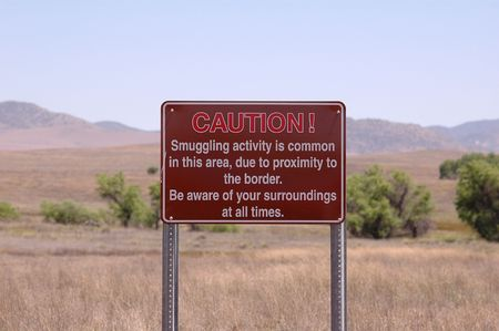 unlawful: A sign on the US and Mexico border warning of illegal activity. Stock Photo