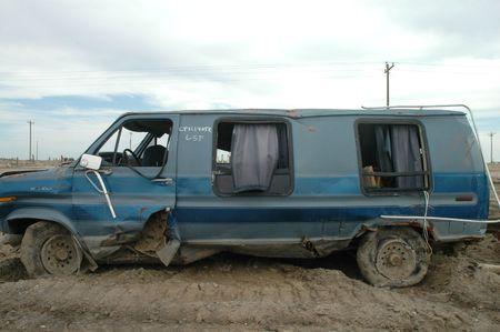 A severely damaged van left over from hurricane Katrina.