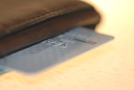 platinum: A  platinum credit card edge in a brown leather wallet. Stock Photo