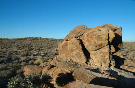 A landscape image from Joshua Tree National Park featuring large boulders and desert. photo