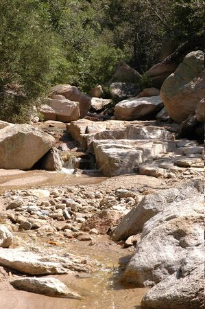 This small stream runs through one of the many mountain ranges in southern Arizona. Stock Photo
