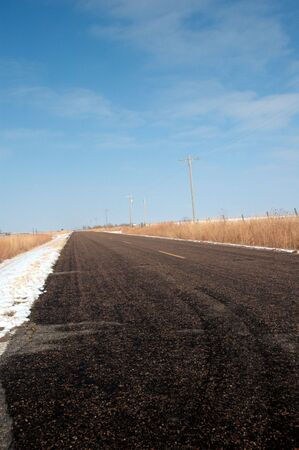 winter escape: A black top road running through the agriculture rich area of central Kansas.
