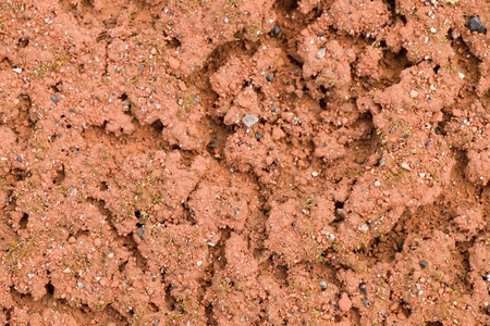 slovenly: Old dry red crushed bricks surface on outdoor tennis ground.