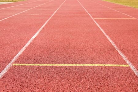 racetrack: White lines and texture of running racetrack, red rubber racetracks in outdoor stadium Stock Photo