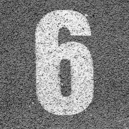racetrack: White track number on red rubber racetrack, texture of running racetracks in small stadium Stock Photo
