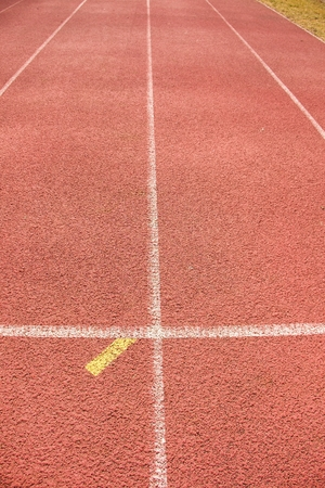 white lines: White lines and texture of running racetrack, red rubber racetracks in outdoor stadium Archivio Fotografico