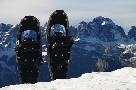 snowshoes: Snowshoes in snow at mountain peak, nice sunny winter day
