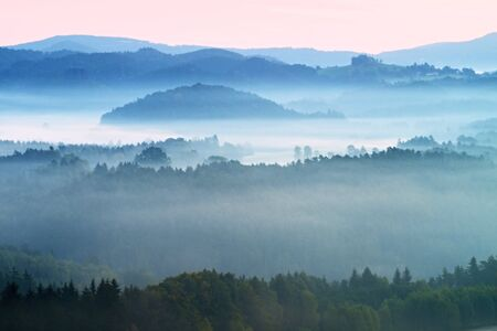 freeze: Autumn fog and clouds above freeze  mountain valley, hilly landscape Stock Photo