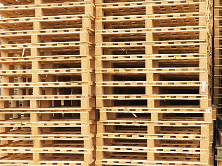 stocked: Texture of wooden euro pallets stocked in high column