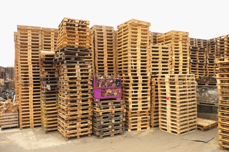 manufactured: Outside stock of old wooden Manufactured standard euro pallets