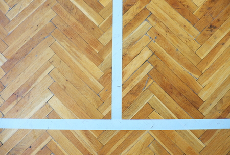 worn out: Worn out wooden floor of sports hall with colorful marking lines.