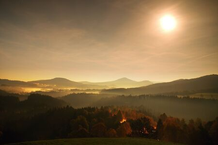 ful: Ful moon night. The fog is moving between hills and peaks of trees a makes with moon rays gentle reflections. Wonderful night