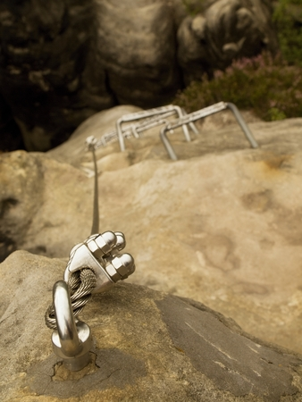 stair climber: Stair climbing rope and iron on mountain via ferrata