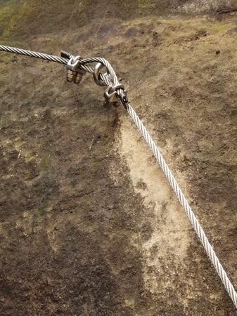 stair climber: Stair climbing rope and iron on mountain via ferrata