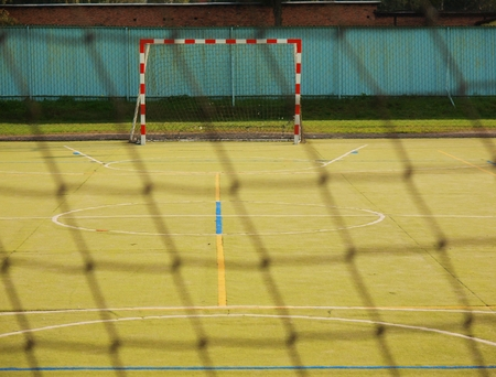 sports field: Empty gate. Outdoor football or handball playground, plastic light green surface on ground Stock Photo