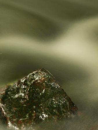stone cold: Slipper stone in cold water stream of Mountan Stock Photo