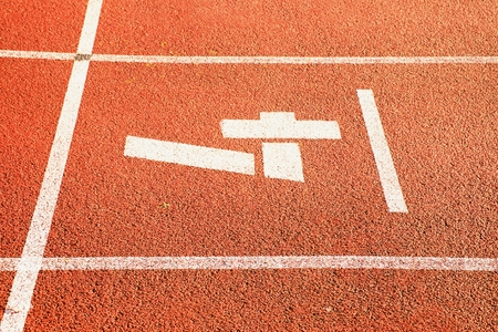 racetrack: Number four. White track number on red rubber racetrack, texture of racetracks in small stadium Stock Photo