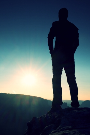 Silhouette of Young Confident and Powerful Man Standing with Hands on Hips, Late Day Sun with Copy Space Reklamní fotografie