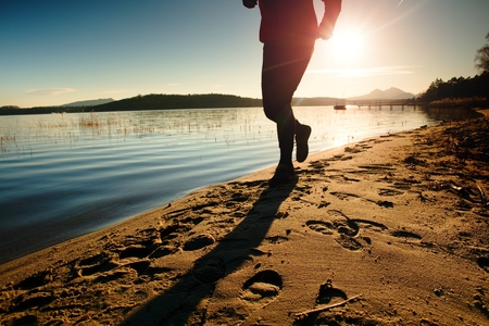 tall man: Tall man in running cloths  at amazing sunset in sport and healthy lifestyle concept and jogging cross country training workout Stock Photo